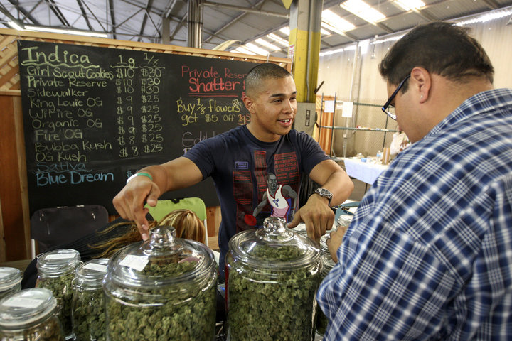 Grower Anthony Nguyen sells marijuana at the medical marijuana farmers market in Los Angeles